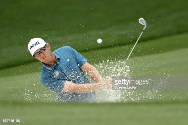 Seamus Power plays a shot from a bunker on the fourth hole during round three of the Wells Fargo Championship at Eagle Point Golf Club on May 6 2017...