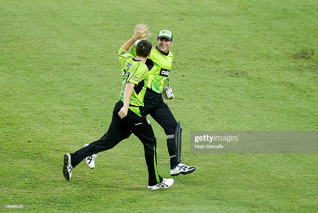 <a gi-track='captionPersonalityLinkClicked' href=/galleries/search?phrase=Sean+Abbott&family=editorial&specificpeople=5800264 ng-click='$event.stopPropagation()'>Sean Abbott</a> and Ben Dunk of the Thunder celebrate a wicket during the T20 Big Bash League match between the Sydney Thunder and the Adelaide Strikers at ANZ Stadium on December 23, 2011 in Sydney, Australia.