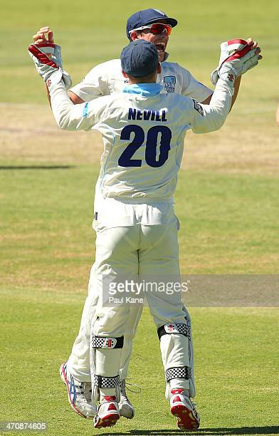 Sean Abbott and Peter Nevill of the Blues celebrate the run out of Marcus North of the Warriors during day two of the Sheffield Shield match between...