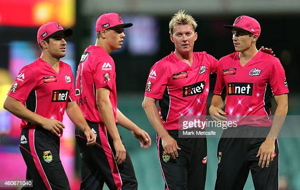 Sean Abbott celebrates with team mates after taking a catch to dismiss Nathan Rimmington of the Renegades during the Big Bash League match between...