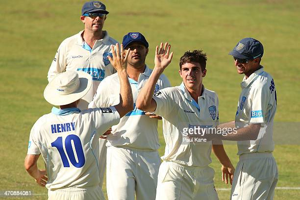 Sean Abbott of the Blues celebrates after dismissing Ashton Turner of the Warriors during day two of the Sheffield Shield match between the Western...