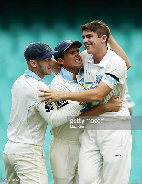 Sean Abbott of the Blues celebrates with Peter Nevill and Stephen O'Keefe after taking the wicket of Nathan Reardon of the Bulls during day one of...