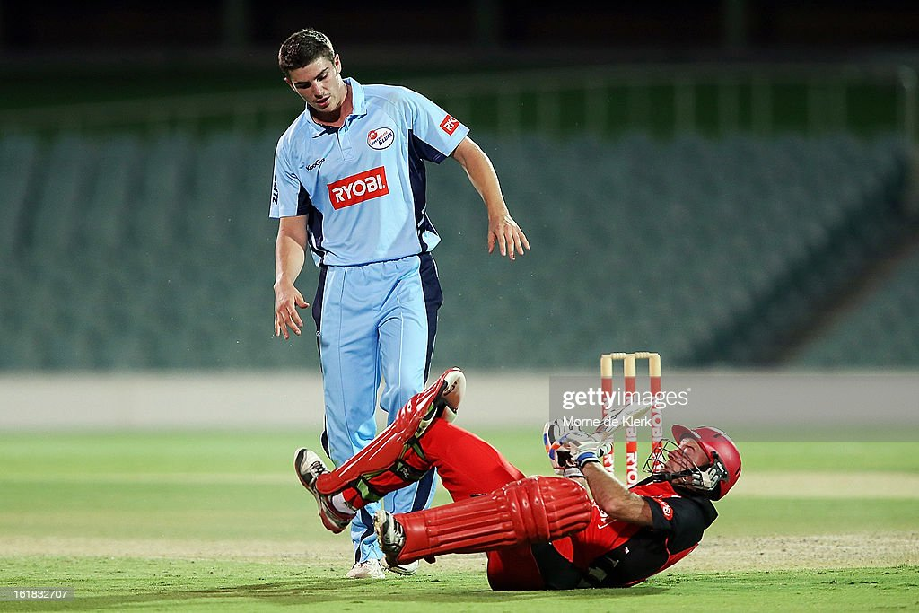 <a gi-track='captionPersonalityLinkClicked' href=/galleries/search?phrase=Sean+Abbott&family=editorial&specificpeople=5800264 ng-click='$event.stopPropagation()'>Sean Abbott</a> of the Blues collides with Tim Ludeman of the Redbacks during the Ryobi One Day Cup match between the South Australian Redbacks and the New South Wales Blues at Adelaide Oval on February 17, 2013 in Adelaide, Australia.