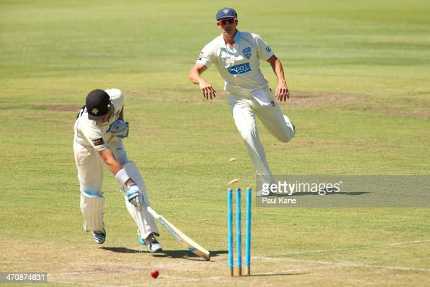 Sean Abbott of the Blues hits the stumps to run out of Marcus North of the Warriors during day two of the Sheffield Shield match between the Western...
