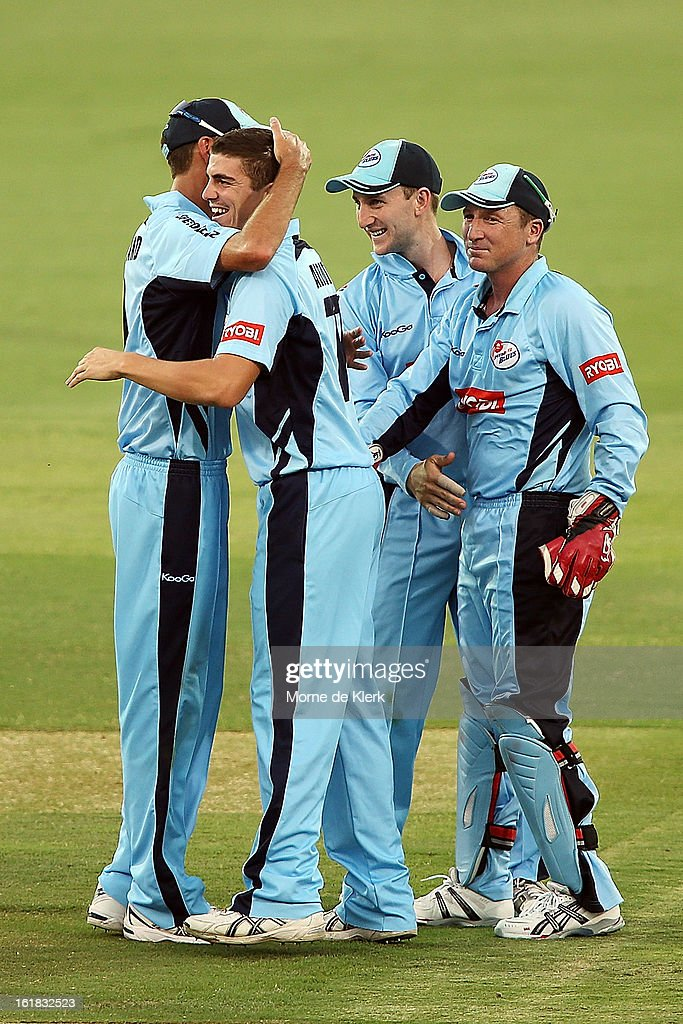 <a gi-track='captionPersonalityLinkClicked' href=/galleries/search?phrase=Sean+Abbott&family=editorial&specificpeople=5800264 ng-click='$event.stopPropagation()'>Sean Abbott</a> of the Blues is congratulated by team mates after getting a wicket during the Ryobi One Day Cup match between the South Australian Redbacks and the New South Wales Blues at Adelaide Oval on February 17, 2013 in Adelaide, Australia.