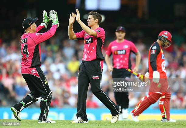 Sean Abbott of the Sixers celebrates with his teammates after dismissing Matthew Wade of the Renegades during the Big Bash League match between the...