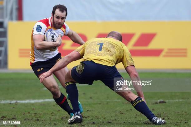 Sean Armstrong of Germany is challenged by Mihai Lazar of Romania during the European Shield Rugby match between Germany and Romania at...