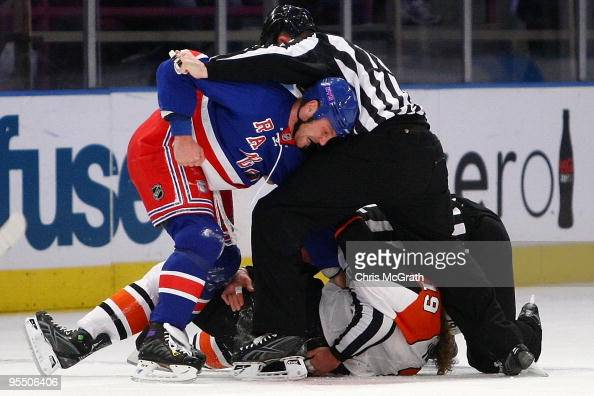 Sean Avery of the New York Rangers fights with Scott Hartnell of the Philadelphia Flyers during their game on December 30 2009 at Madison Square...