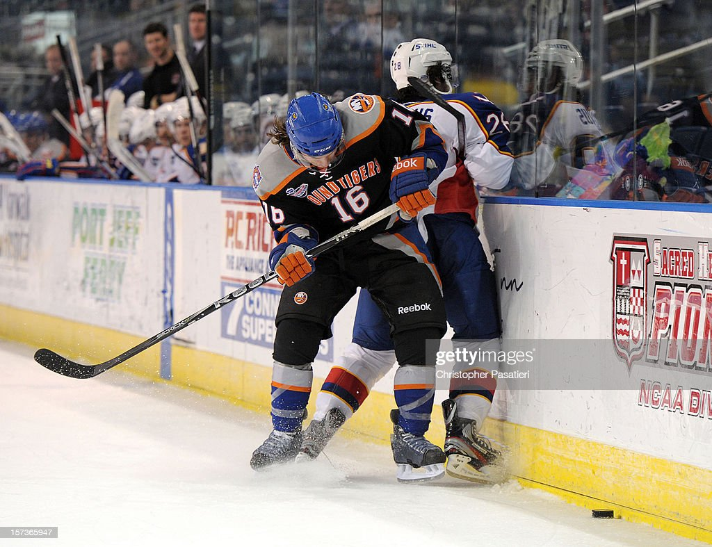 Sean Backman #16 of the Bridgeport Sound Tigers checks Nick Schaus #28 of the Norfolk Admirals during an American Hockey League game on December 2, 2012 at the Webster Bank Arena in Bridgeport, Connecticut. The Admirals defeated the Sound Tigers 4-1.