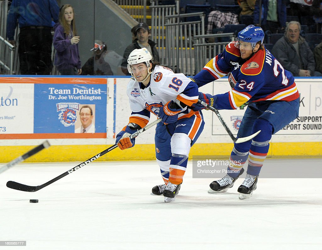 Sean Backman #16 of the Bridgeport Sound Tigers is checked by John Mitchell #24 of the Norfolk Admirals as he prepares to the a shot on goal during an American Hockey League game on February 2, 2013 at the Webster Bank Arena at Harbor Yard in Bridgeport, Connecticut.