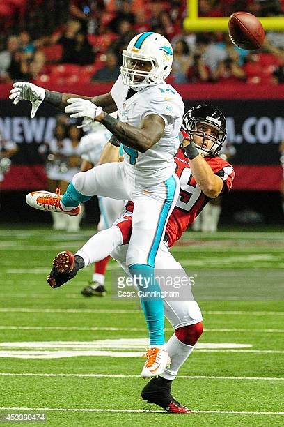 Sean Baker of the Atlanta Falcons breaks up a pass intended for Jarvis Landry of the Miami Dolphins in the third quarter of a preseason game at the...