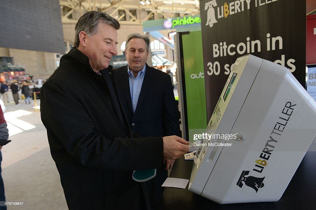 Sean Belka purchases Bitcoin from a newly installed Bitcoin ATM at South Station February 20, 2014 in Boston, Massachusetts. The ATM was placed by Liberty Teller to help inform people about the digital currency, which can be bought and sold anonymously, and can be used at a number of online retailers in place of cash or credit cards.
