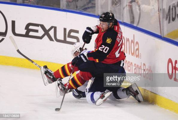 Sean Bergenheim of the Florida Panthers falls over Matt Gilroy of the Tampa Bay Lightning during a NHL game at the BankAtlantic Center on November 25...