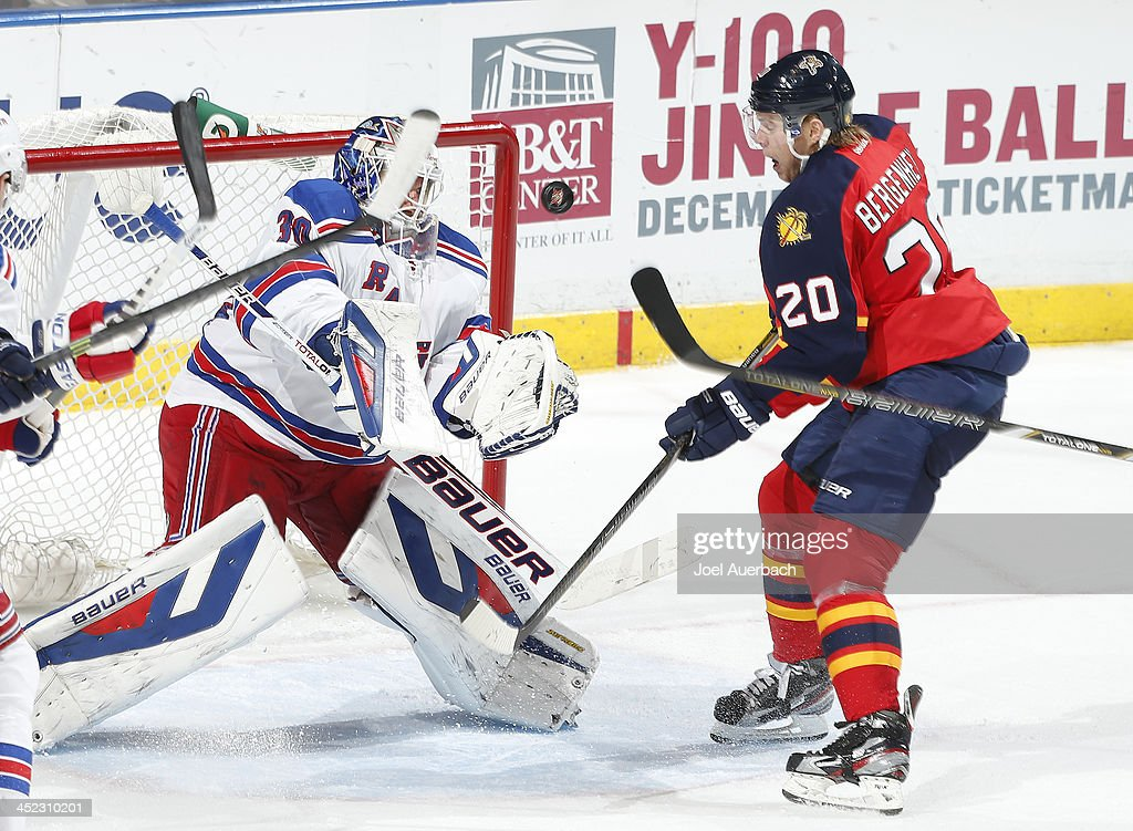 <a gi-track='captionPersonalityLinkClicked' href=/galleries/search?phrase=Sean+Bergenheim&family=editorial&specificpeople=208830 ng-click='$event.stopPropagation()'>Sean Bergenheim</a> #20 of the Florida Panthers is unable to get the rebound on a save by goaltender <a gi-track='captionPersonalityLinkClicked' href=/galleries/search?phrase=Henrik+Lundqvist&family=editorial&specificpeople=217958 ng-click='$event.stopPropagation()'>Henrik Lundqvist</a> #30 of the New York Rangers at the BB&T Center on November 27, 2013 in Sunrise, Florida. The Rangers defeat the Panthers 5-2.