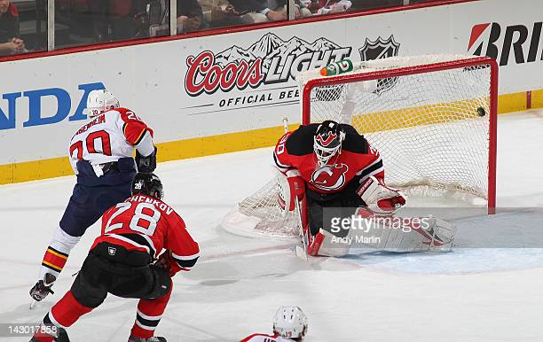 Sean Bergenheim of the Florida Panthers puts the puck past Martin Brodeur of the New Jersey Devils for a first period goal in Game Three of the...