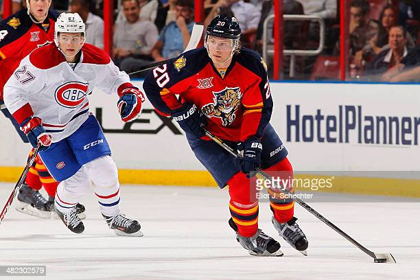 Sean Bergenheim of the Florida Panthers skates with the puck against Alex Galchenyuk of the Montreal Canadiens at the BBT Center on March 29 2014 in...