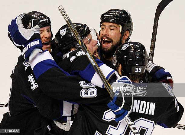 Sean Bergenheim of the Tampa Bay Lightning celebrates his second period goal against the Boston Bruins with teammates in Game Four of the Eastern...