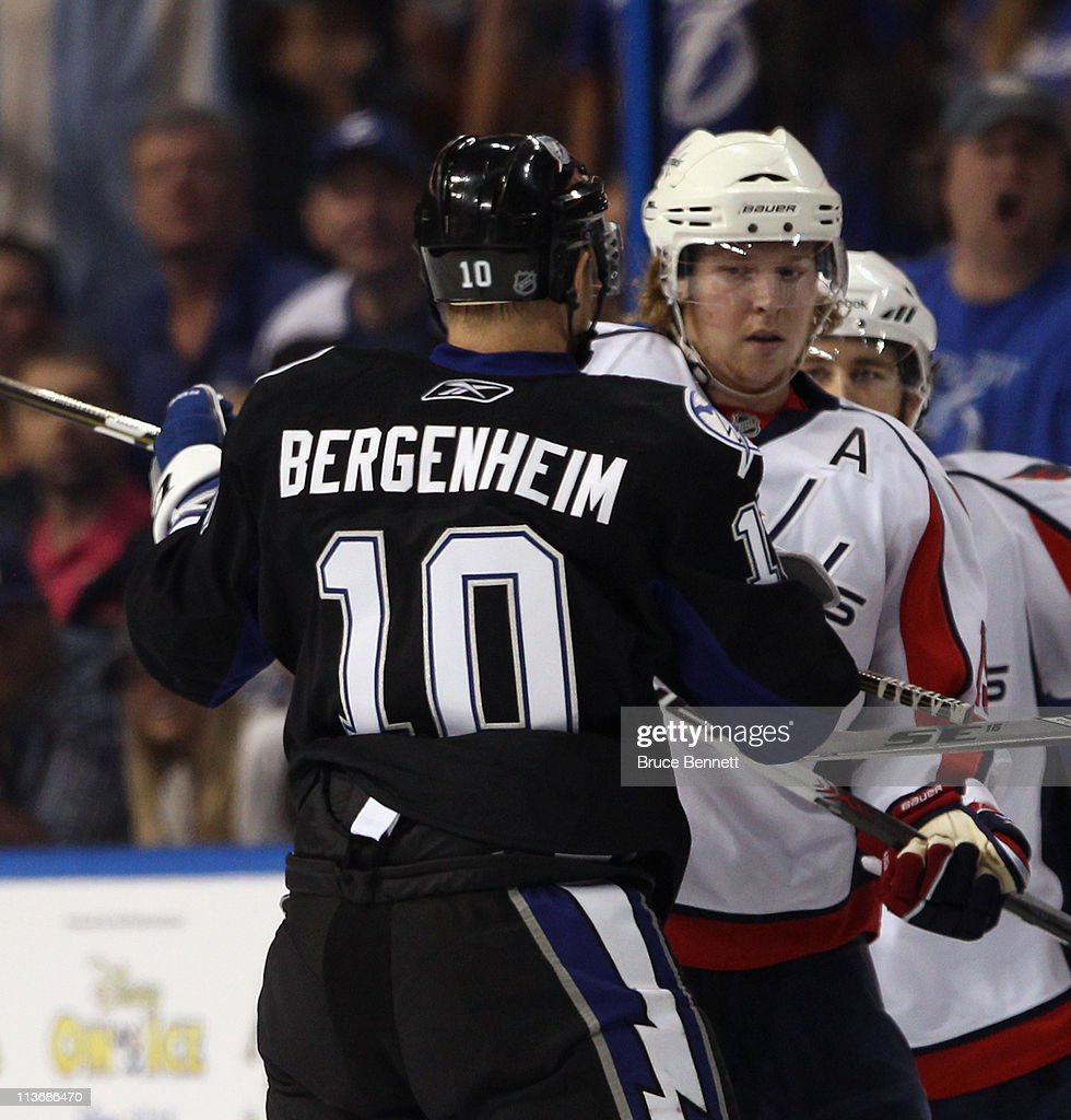 Sean Bergenheim of the Tampa Bay Lightning confronts Nicklas Backstrom of the Washington Capitals in the first period in Game Four of the Eastern...