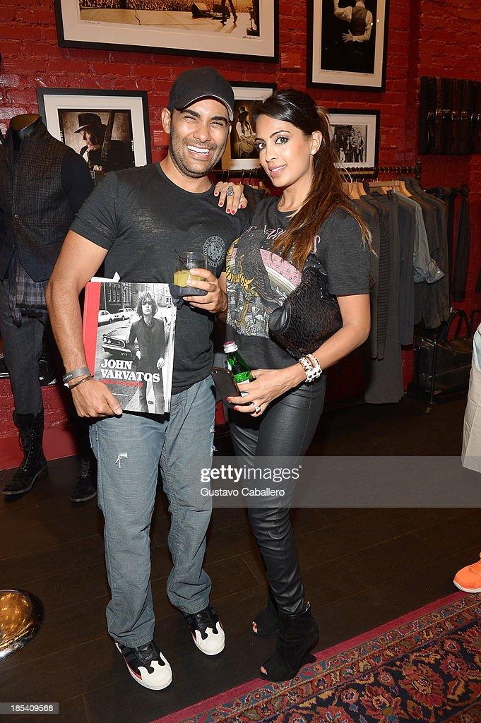 Sean Bhagwan and Sunita Bhagwa attends the Rock in Fashion Book Launch at John Varvatos South Beach Miami on October 19, 2013 in Miami, Florida.