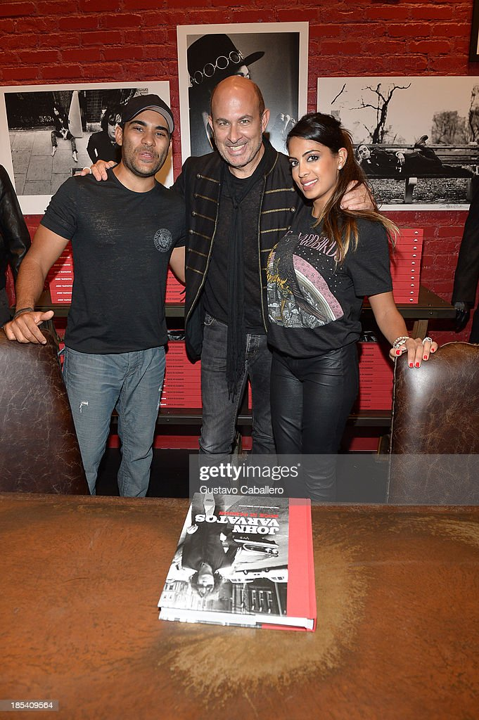Sean Bhagwan,John Varvatos and Sunita Bhagwa attends the Rock in Fashion Book Launch at John Varvatos South Beach Miami on October 19, 2013 in Miami, Florida.