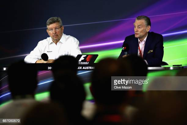 Sean Bratches Managing Director of the Formula One Group talks in a press conference with Ross Brawn Managing Director of the Formula One Group...
