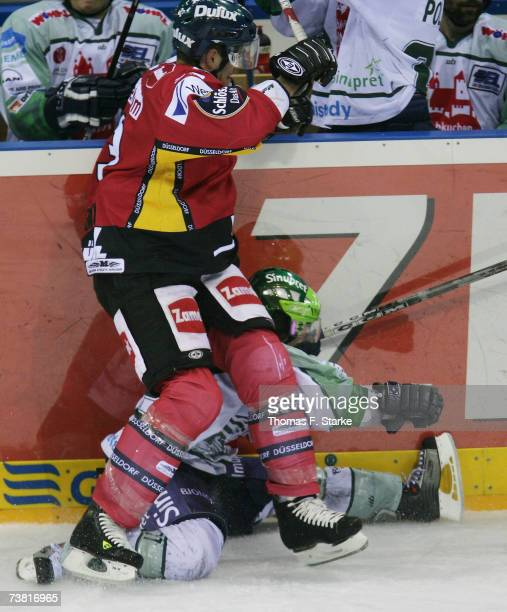 Sean Brown tackles Petr Fical of Nuremberg during the DEL Bundesliga play off semi final game between DEG Metro Stars and Nuremberg Ice Tigers at the...