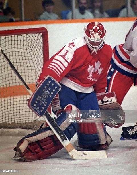 Sean Burke of Team Canada stops a shot against Team USA during a warmup game for the 1988 Olympics on January 18 1988 at Maple Leaf Gardens in...