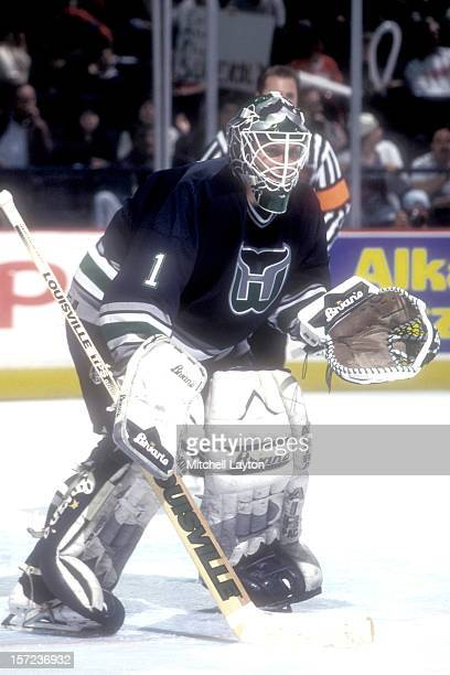 Sean Burke of the Hartford Whalers in position during a hockey game against the Washington Capitals on December 30 1995 at USAir Arena in Landover...