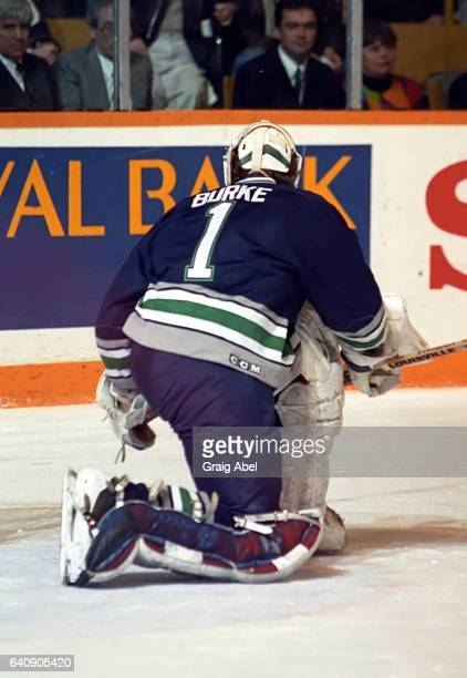 Sean Burke of the Hartford Whalers stops a shot against the Toronto Maple Leafs during NHL game action on March 10 1993 at Maple Leaf Gardens in...