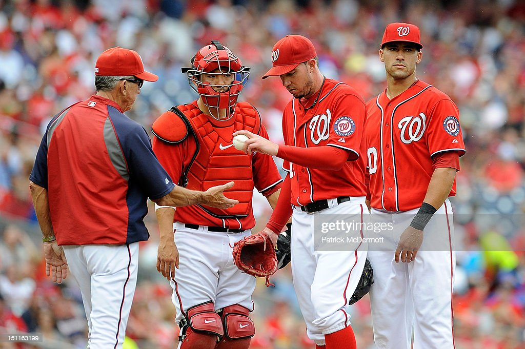 <a gi-track='captionPersonalityLinkClicked' href=/galleries/search?phrase=Sean+Burnett&family=editorial&specificpeople=810641 ng-click='$event.stopPropagation()'>Sean Burnett</a> #17 of the Washington Nationals hands the ball to manager <a gi-track='captionPersonalityLinkClicked' href=/galleries/search?phrase=Davey+Johnson+-+Baseball+Manager&family=editorial&specificpeople=93273 ng-click='$event.stopPropagation()'>Davey Johnson</a> after being pulled in the seventh inning against the St. Louis Cardinals at Nationals Park on September 2, 2012 in Washington, DC.
