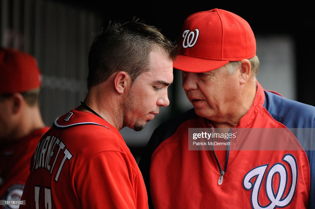 <a gi-track='captionPersonalityLinkClicked' href=/galleries/search?phrase=Sean+Burnett&family=editorial&specificpeople=810641 ng-click='$event.stopPropagation()'>Sean Burnett</a> #17 talks with pitching coach Steve McCatty #43 of the Washington Nationals in the dugout during a game against the St. Louis Cardinals at Nationals Park on September 2, 2012 in Washington, DC.