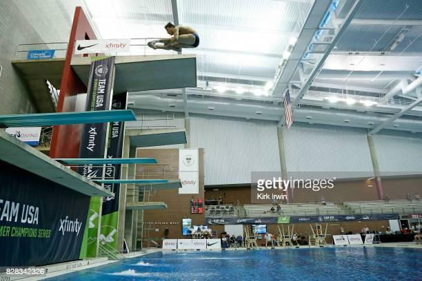 Sean Burston of North Carolina Diving competes during the Senior Men's 3m Springboard Semifinal during the 2017 USA Diving Summer National...
