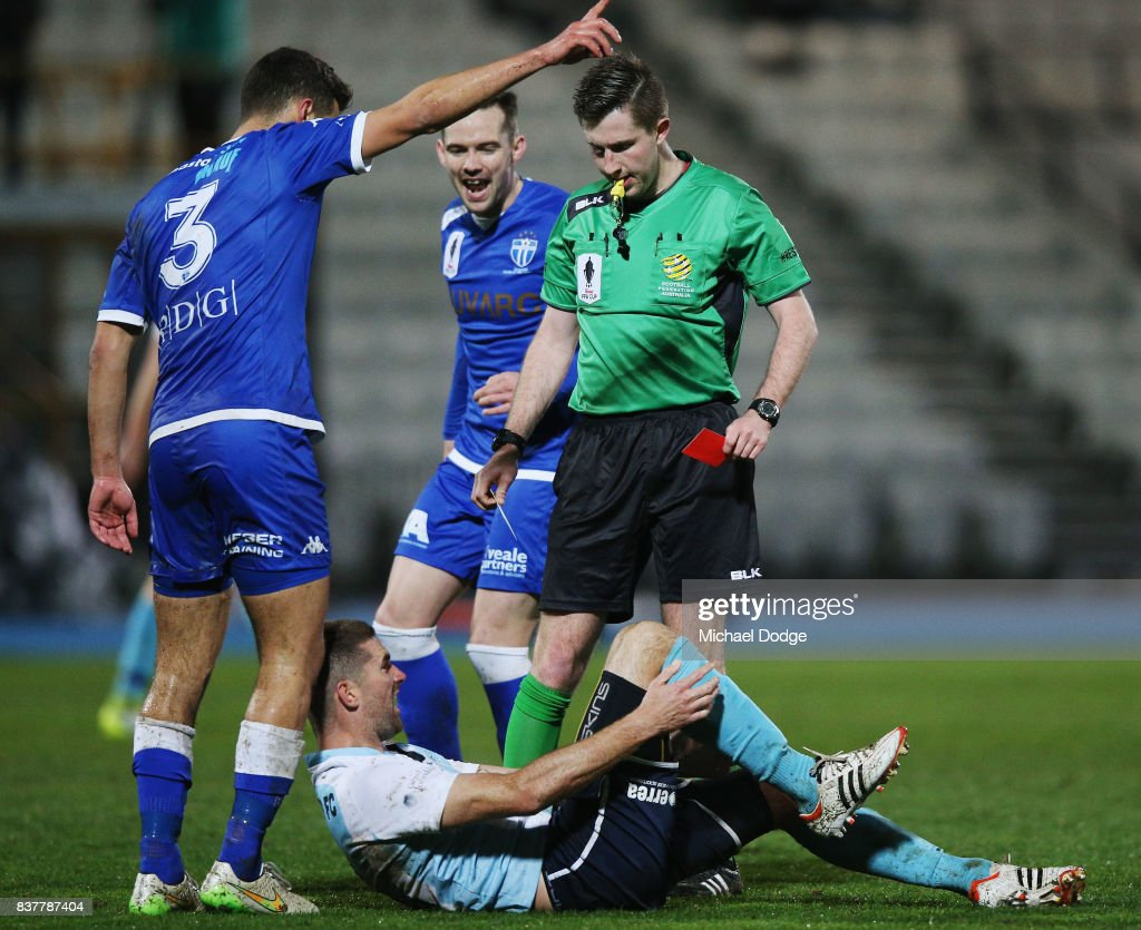 Sean Canham of Sorrento is red carded by the referee and as Kristian Konstantinidis of South Melbourne gestures during the FFA Cup round of 16 match between between South Melbourne FC and Sorrento FC at Lakeside Stadium on August 23, 2017 in Melbourne, Australia.