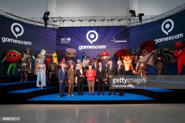 Sean Casey Henriette Reker Armin Laschet Felix Falk Tobias Haar and Gerald Boese welcome German Chancellor Angela Merkel at the Gamescom 2017 gaming...