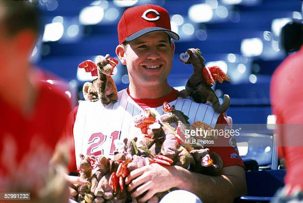 Sean Casey of the Cincinnati Reds poses with souvenirs before an MLB game on March 17 1998 at Cinergy Field in Cincinnati Ohio