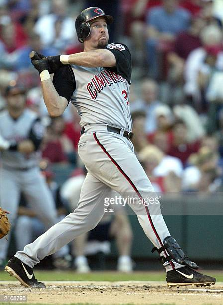 Sean Casey of the Cincinnati Reds watches as the ball flies out of the park for a solo home run against the St Louis Cardinals on June 24 2003 at...