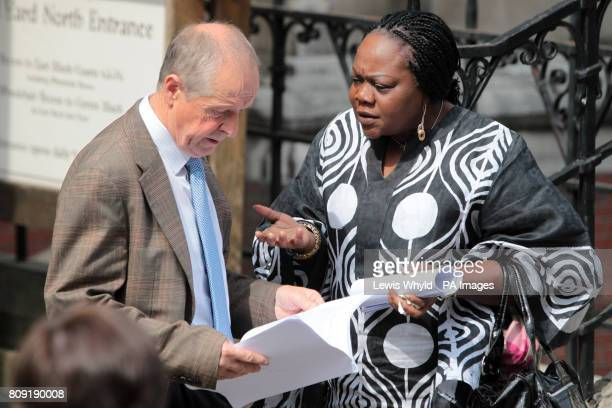 Sean Cassidy and Marie FatayiWilliams who both lost sons in the July bombings study the written verdict outside the High Court after coroner Lady...