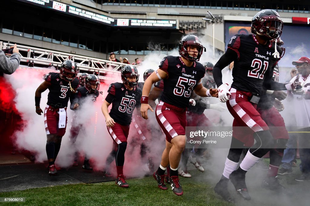Sean Chandler #3 of the Temple Owls emerges with teammates Corey Lerch #59, Kevin DeCaesar #53 and Derrek Thomas #21 as they enter the game to face the UCF Knights at Lincoln Financial Field on November 18, 2017 in Philadelphia, Pennsylvania. UCF defeated Temple 45-19.