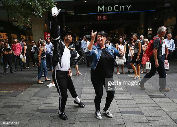 Sean Christopher gives dancing tips to interested shoppers during a Michael Jackson 'Moonwalking' demonstration at Pitt St Mall on February 24 2015...
