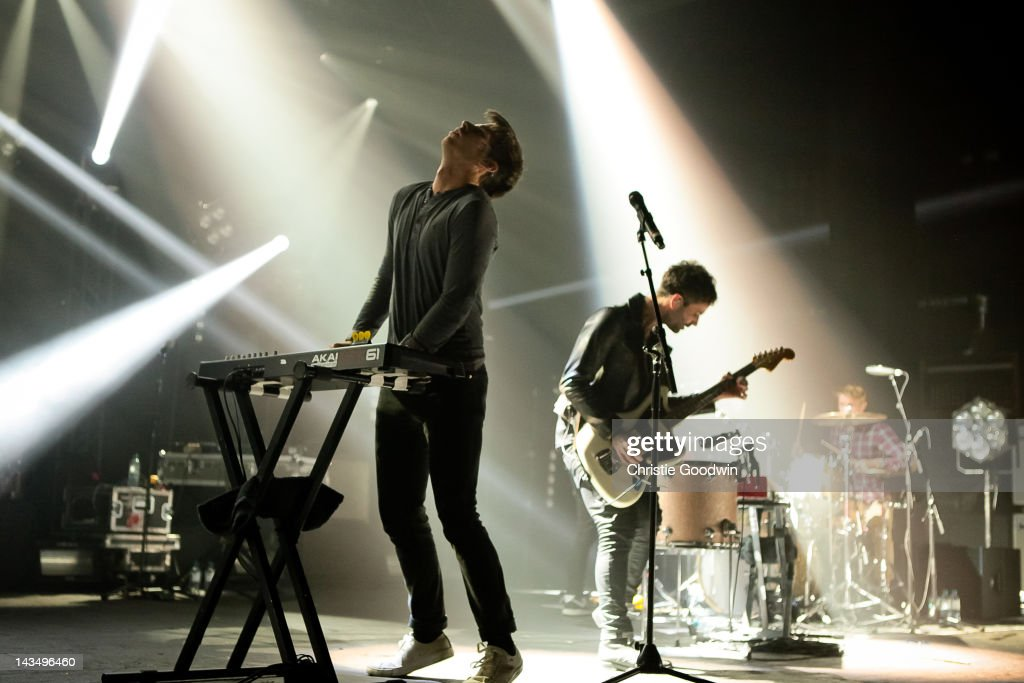 Sean Cimino and Cubbie Fink of Foster The People perform on stage at Brixton Academy on April 27 2012 in London United Kingdom