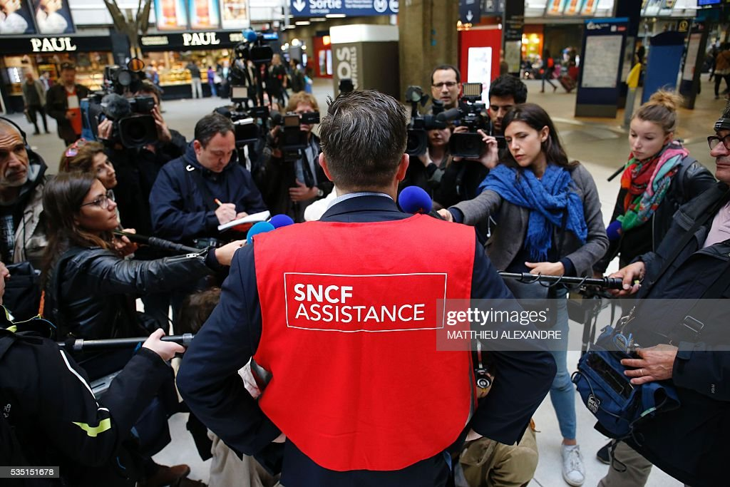 Sean Clairin, a responsible of the France's national state-owned railway company SNCF traffic speaks to the press because the train traffic was suspended since this morning at the start and towards the Paris-Montparnasse rail station, due to a failure of traffic management system for the moment unexplained, according to the SNCF, on May 29, 2016 in Paris.