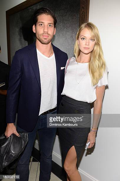 Sean Clayton and Lindsay Ellingson attend the Peter Lindbergh artist reception presented by Vladimir Restoin Roitfeld on September 7 2013 in New York...