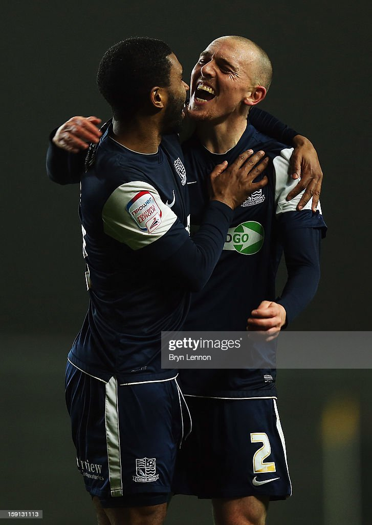 Sean Clohessy of Southend United celebrates with team mate Gavin Tomlin after scoring during the Johnstone's Paint Trophy Southern Section Semi Final between Oxford United and Southend United at the Kassam Stadium on January 8, 2013 in Oxford, England.