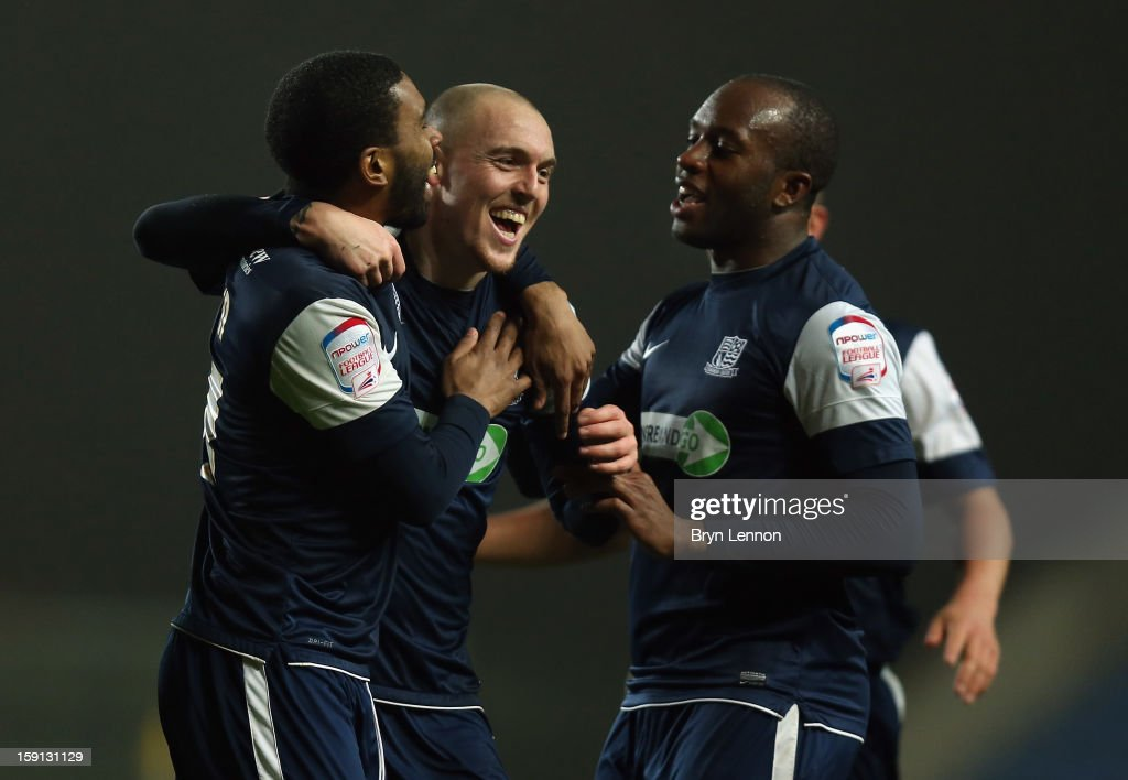Sean Clohessy of Southend United celebrates with team mates Gavin Tomlin (l) and Anthony Straker (r) after scoring during the Johnstone's Paint Trophy Southern Section Semi Final between Oxford United and Southend United at the Kassam Stadium on January 8, 2013 in Oxford, England.