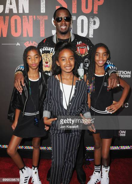 Sean Combs and daughters arrive at the Los Angeles Premiere Of 'Can't Stop Won't Stop' at Writers Guild of America West on June 21 2017 in Los...