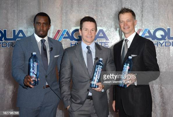Sean Combs Mark Wahlberg and CEO of AQUAhydrate John Cochran pose onstage while hosting a press conference to announce their newest venture Water...