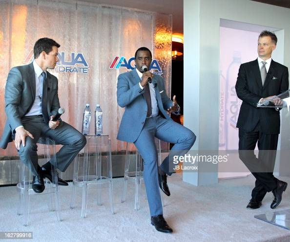 Sean Combs Mark Wahlberg and John Cochran pose onstage while hosting a press conference to announce their newest venture Water Brand AQUAhydrate on...