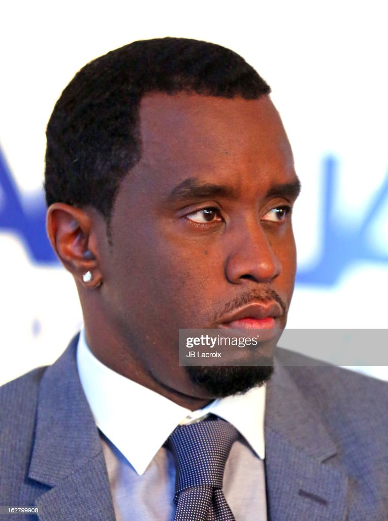 <a gi-track='captionPersonalityLinkClicked' href=/galleries/search?phrase=Sean+Combs&family=editorial&specificpeople=178993 ng-click='$event.stopPropagation()'>Sean Combs</a> speak onstage while hosting a press conference to announce their newest venture, Water Brand AQUAhydrate on February 27, 2013 in Los Angeles, California.