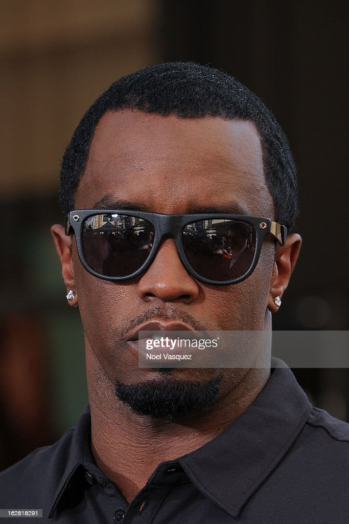 <a gi-track='captionPersonalityLinkClicked' href=/galleries/search?phrase=Sean+Combs&family=editorial&specificpeople=178993 ng-click='$event.stopPropagation()'>Sean Combs</a> visits Extra at The Grove on February 27, 2013 in Los Angeles, California.
