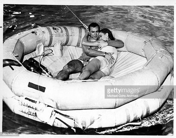 Sean Connery as James Bond protects Claudine Auger as Domino in a scene from the movie 'Thunderball' circa 1965